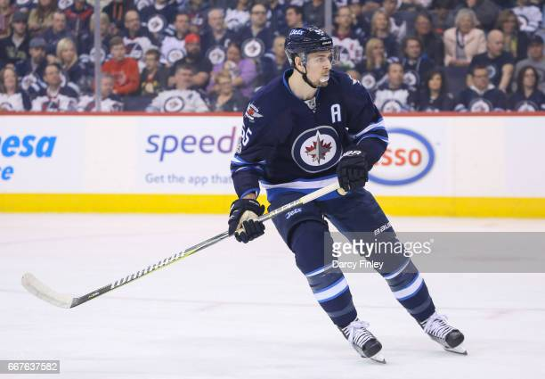 Mark Scheifele of the Winnipeg Jets keeps an eye on the play during first period action against the Nashville Predators at the MTS Centre on April 8...