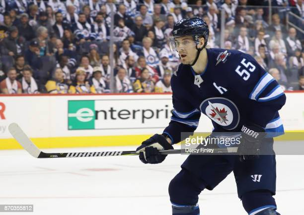 Mark Scheifele of the Winnipeg Jets keeps an eye on the play during second period action against the Pittsburgh Penguins at the Bell MTS Place on...