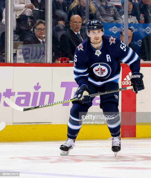 Mark Scheifele of the Winnipeg Jets keeps an eye on the play during second period action against the Minnesota Wild at the Bell MTS Place on November...