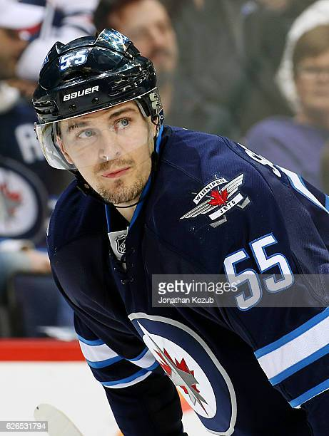 Mark Scheifele of the Winnipeg Jets looks on during a second period stoppage in play against the New Jersey Devils at the MTS Centre on November 29...
