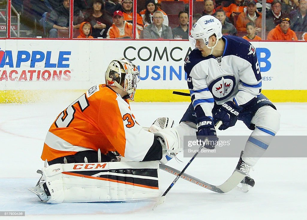 Mark Scheifele #55 of the Winnipeg Jets misses a first period deflection against Steve Mason #35 of the Philadelphia Flyers at the Wells Fargo Center on March 28, 2016 in Philadelphia, Pennsylvania.
