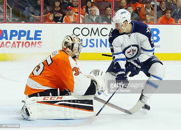 Mark Scheifele of the Winnipeg Jets misses a first period deflection against Steve Mason of the Philadelphia Flyers at the Wells Fargo Center on...