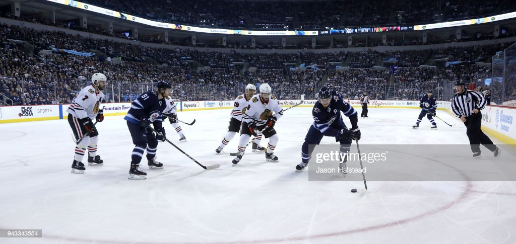 Mark Scheifele #55 of the Winnipeg Jets moves the puck against the Chicago Blackhawks during NHL action on April 7, 2018 at Bell MTS Place in Winnipeg, Manitoba.