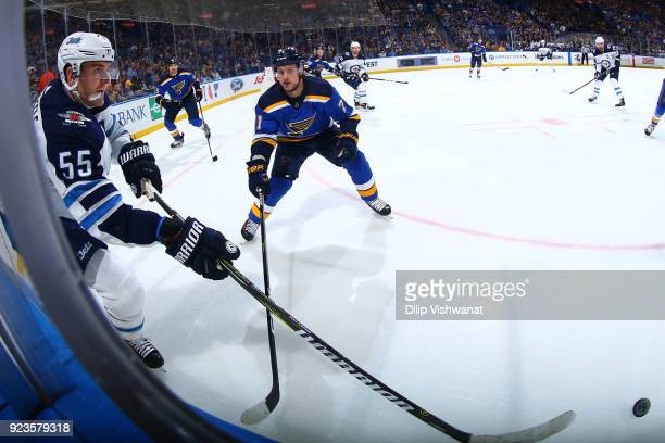 Mark Scheifele of the Winnipeg Jets passes the puck against Vladimir Sobotka of the St Louis Blues at Scottrade Center on February 23 2018 in St...