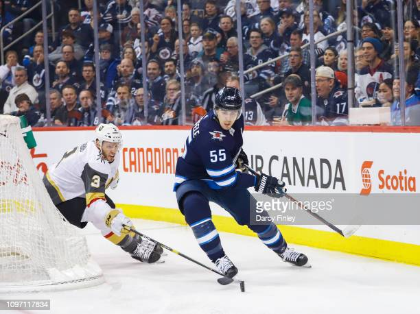 Mark Scheifele of the Winnipeg Jets plays the puck around the net as Brayden McNabb of the Vegas Golden Knights gives chase during first period...