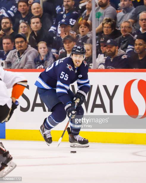 Mark Scheifele of the Winnipeg Jets plays the puck down the ice during third period action against the Anaheim Ducks at the Bell MTS Place on January...