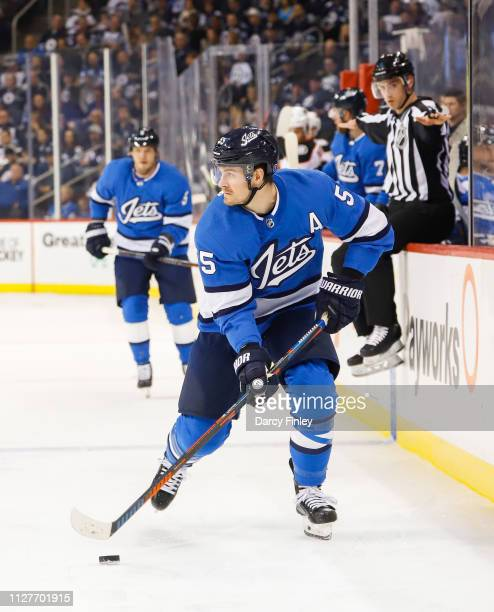 Mark Scheifele of the Winnipeg Jets plays the puck down the ice during second period action against the Anaheim Ducks at the Bell MTS Place on...