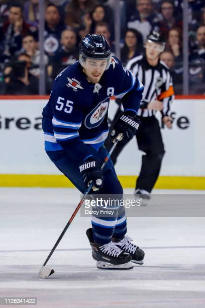 Mark Scheifele of the Winnipeg Jets plays the puck down the ice during first period action against the San Jose Sharks at the Bell MTS Place on...