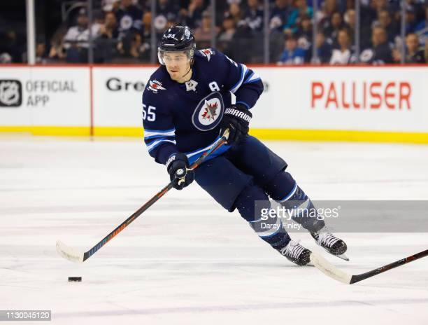 Mark Scheifele of the Winnipeg Jets plays the puck down the ice during first period action against the New York Rangers at the Bell MTS Place on...