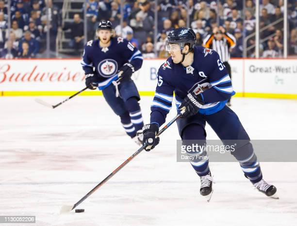 Mark Scheifele of the Winnipeg Jets plays the puck down the ice during second period action against the New York Rangers at the Bell MTS Place on...