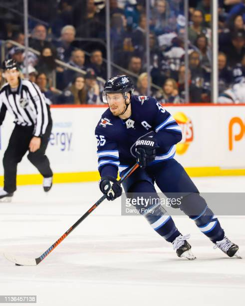 Mark Scheifele of the Winnipeg Jets plays the puck down the ice during second period action against the San Jose Sharks at the Bell MTS Place on...