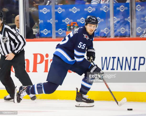 Mark Scheifele of the Winnipeg Jets plays the puck up the ice during first period action against the Anaheim Ducks at the Bell MTS Place on January...
