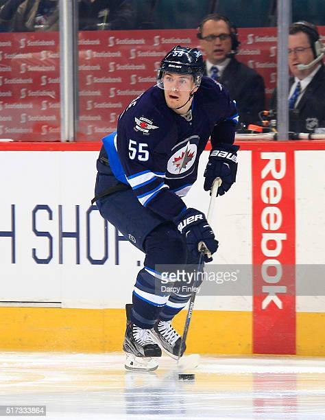 Mark Scheifele of the Winnipeg Jets plays the puck up the ice during first period action against the Los Angeles Kings at the MTS Centre on March 24...