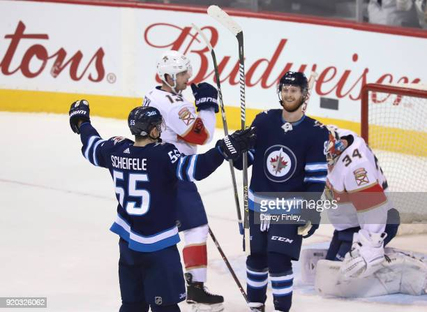 Mark Scheifele of the Winnipeg Jets raises his arms as he celebrates his second period goal against the Florida Panthers with teammate Kyle Connor at...