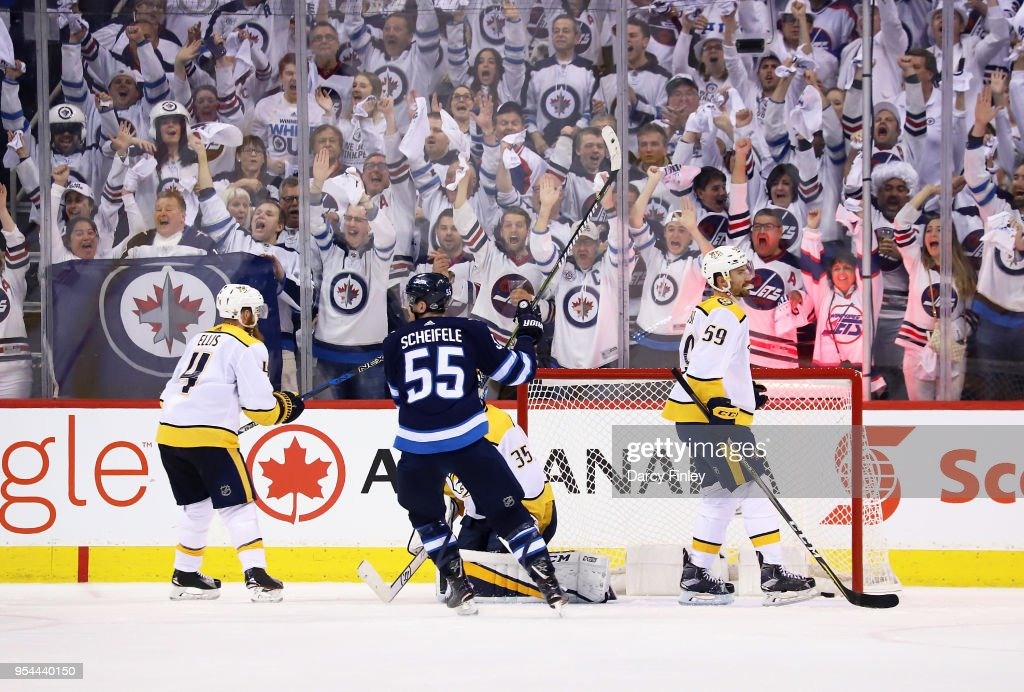 Mark Scheifele #55 of the Winnipeg Jets raises his stick in celebration after teammate Patrik Laine #29 (not shown) scores a late third period goal against the Nashville Predators in Game Four of the Western Conference Second Round during the 2018 NHL Stanley Cup Playoffs at the Bell MTS Place on May 3, 2018 in Winnipeg, Manitoba, Canada.