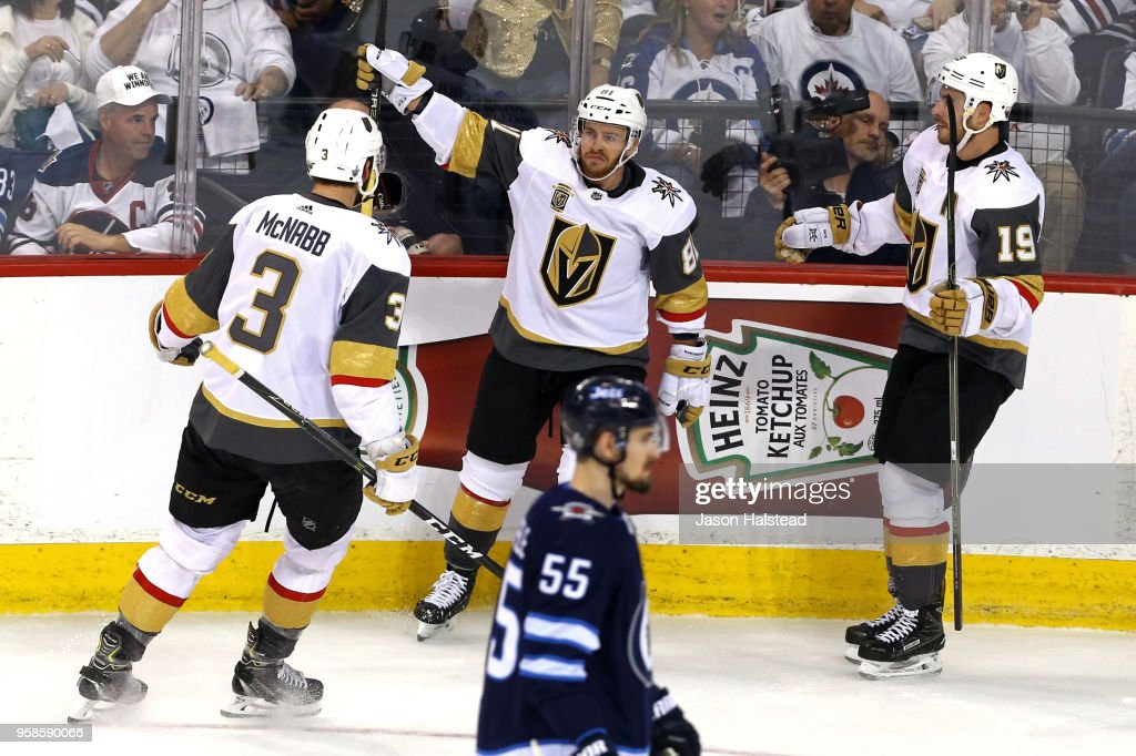 Mark Scheifele #55 of the Winnipeg Jets reacts as Jonathan Marchessault #81 is congratulated by his teammates Brayden McNabb #3 and Reilly Smith #19 of the Vegas Golden Knights after scoring a first period goal in Game Two of the Western Conference Finals during the 2018 NHL Stanley Cup Playoffs at Bell MTS Place on May 14, 2018 in Winnipeg, Canada.