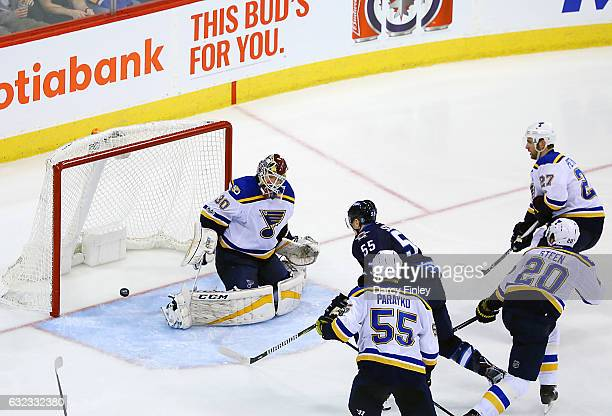 Mark Scheifele of the Winnipeg Jets redirects the puck in past goaltender Pheonix Copley of the St Louis Blues for a third period goal at the MTS...