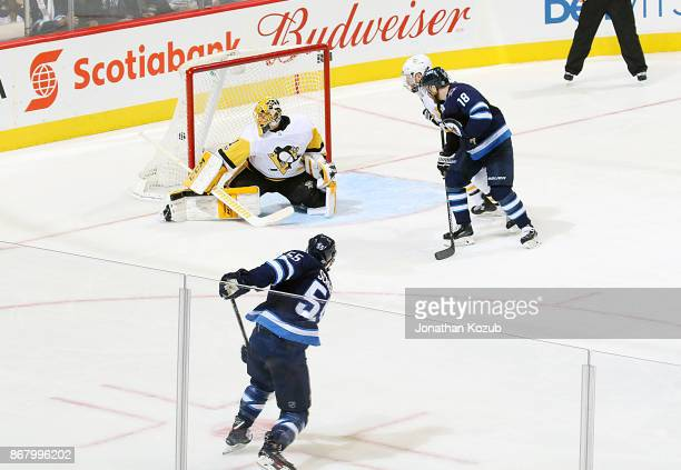 Mark Scheifele of the Winnipeg Jets rips a shot past goaltender Casey Desmith of the Pittsburgh Penguins for a third period goal at the Bell MTS...