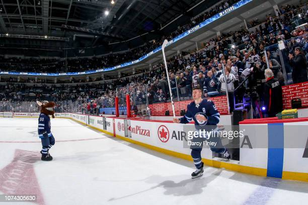 Mark Scheifele of the Winnipeg Jets salutes the fans after receiving first star honours following a 54 overtime victory over the Tampa Bay Lightning...