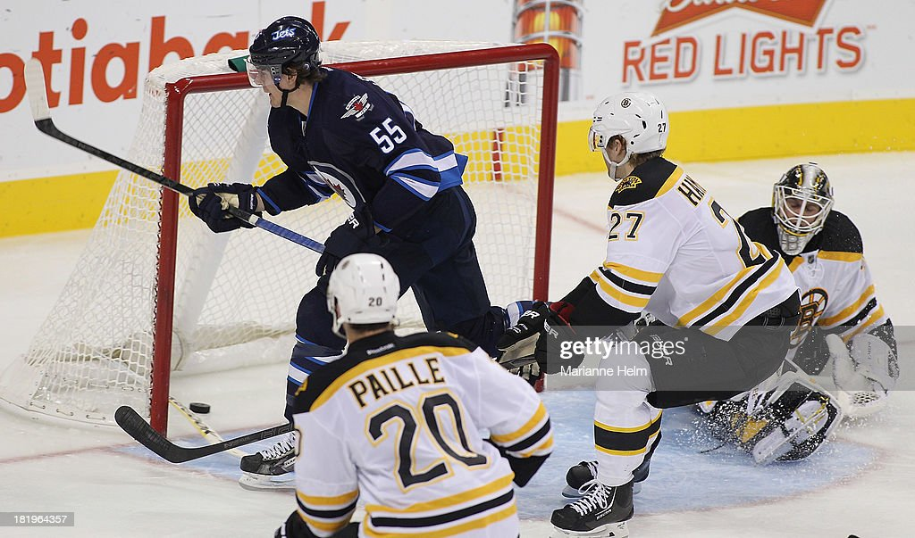 Mark Scheifele #55 of the Winnipeg Jets scores a goal against Niklas Svedberg #72 of the Boston Bruins in third period action during an NHL preseason game at the MTS Centre on September 26, 2013 in Winnipeg, Manitoba, Canada.