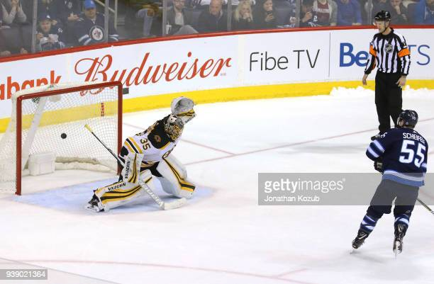 Mark Scheifele of the Winnipeg Jets shoots the puck behind goaltender Anton Khudobin of the Boston Bruins for a shootout goal at the Bell MTS Place...