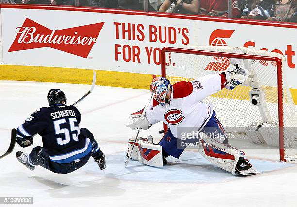 Mark Scheifele of the Winnipeg Jets shoots the puck past goaltender Mike Condon of the Montreal Canadiens for a second period goal at the MTS Centre...