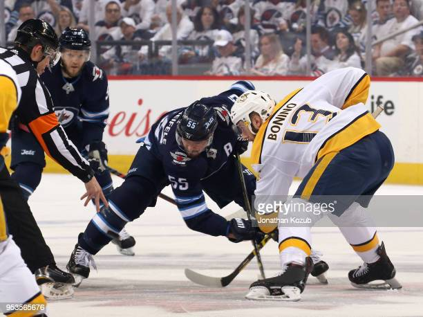 Mark Scheifele of the Winnipeg Jets takes a first period faceoff against Nick Bonino of the Nashville Predators in Game Three of the Western...