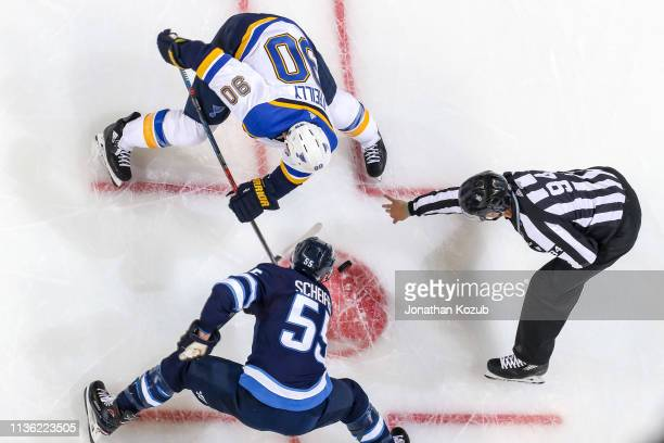 Mark Scheifele of the Winnipeg Jets takes a second period face-off against Ryan O'Reilly of the St. Louis Blues in Game One of the Western Conference...
