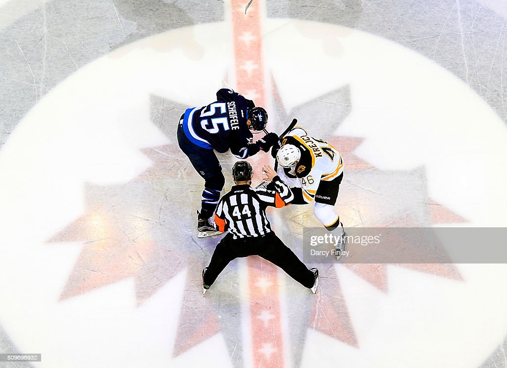 Mark Scheifele #55 of the Winnipeg Jets takes a third period face-off against David Krejci #46 of the Boston Bruins at the MTS Centre on February 11, 2016 in Winnipeg, Manitoba, Canada.