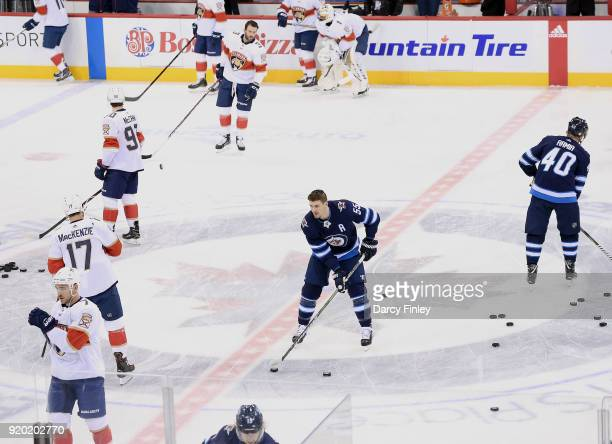 Mark Scheifele of the Winnipeg Jets takes part in the pregame warm up prior to NHL action against the Florida Panthers at the Bell MTS Place on...