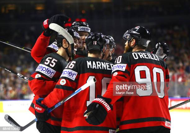 Mark Schleifele of Canada is congratulated after scoring the first goal during the 2017 IIHF Ice Hockey World Championship Quarter Final game between...