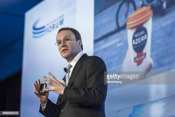 Mark Schneider chief executive officer of Nestle SA gestures as he speaks during a panel session at the 61st Global Summit of the Consumer Goods...