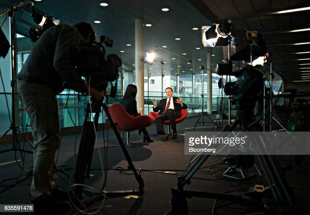 Mark Schneider chief executive officer of Nestle SA right speaks with Caroline Connan Bloomberg News reporter during a Bloomberg Television interview...