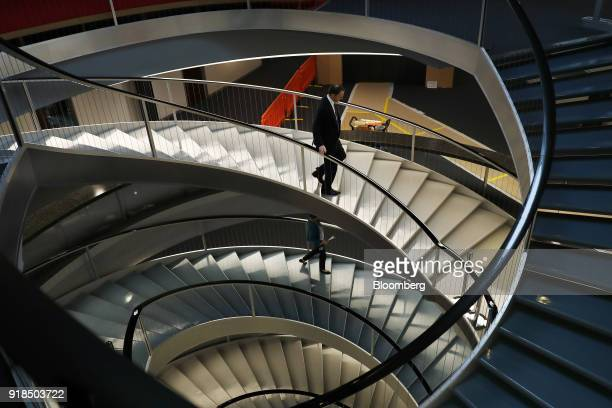 Mark Schneider chief executive officer of Nestle SA walks down a spiral staircase as he departs a news conference after delivering the company's full...