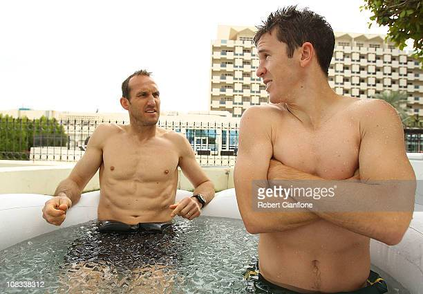 Mark Schwarzer and Matt McKay sit in an ice bath during an Australian Socceroos recovery session at the Marriott Hotel on January 26 2011 in Doha...