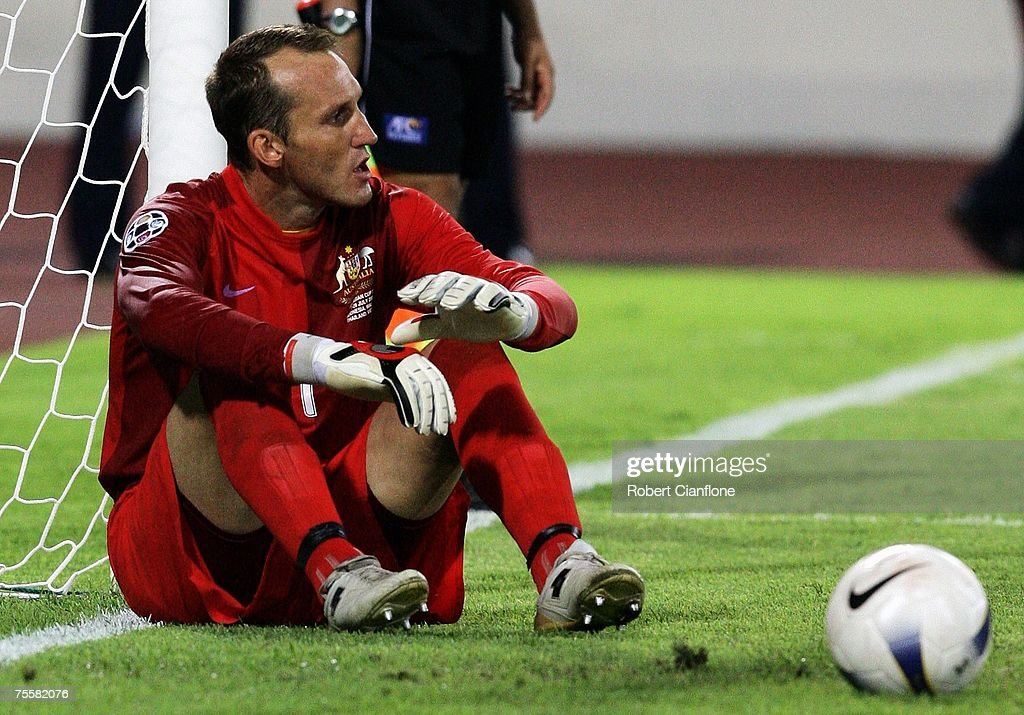 Mark Schwarzer looks dejected after missing the first penalty during a penalty shoot-out for the AFC Asian Cup 2007 Quarter Final between Japan and the Australian Socceroos at My Dinh National Stadium July 21, 2007 in Hanoi, Vietnam.