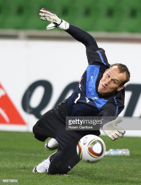 Mark Schwarzer of Australia dives for the ball during an Australian Socceroos training session at AAMI Park on May 19 2010 in Melbourne Australia