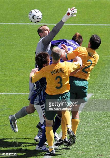 Mark Schwarzer of Australia fails to stop the cross by Shunsuke Nakamura of Japan to allow the first goal to Japan during the FIFA World Cup Germany...