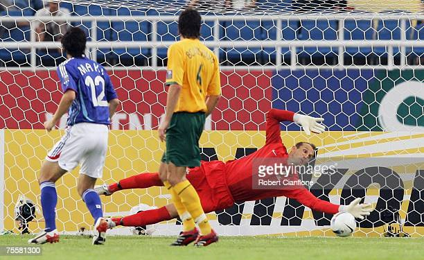 Mark Schwarzer of Australia makes a diving save to deny Japan a goal during the AFC Asian Cup 2007 Quarter Final between Japan and the Australian...