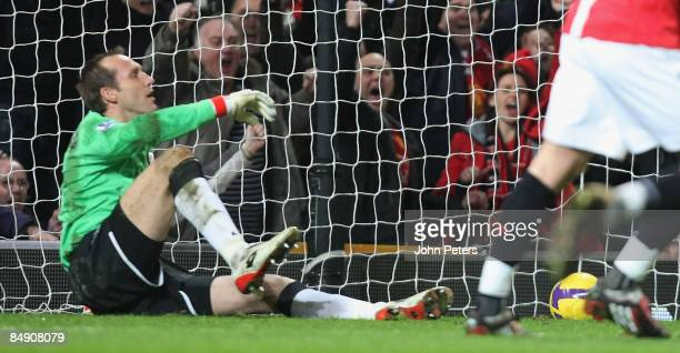 Mark Schwarzer of Fulham concedes the first goal during the Barclays Premier League match between Manchester United and Fulham at Old Trafford on...