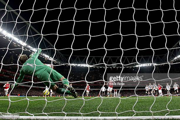 Mark Schwarzer of Fulham saves a penaly kick from Mikel Arteta of Arsenal during the Barclays Premier League match between Arsenal and Fulham at...