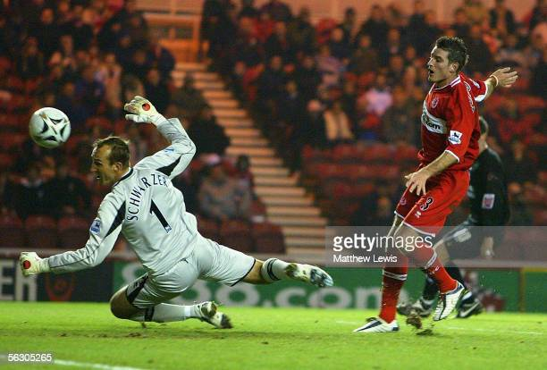 Mark Schwarzer of Middlesbrough looks on as Franck Quedrue of Middlesbrough scores an own goal during the Carling Cup Fourth Round match between...