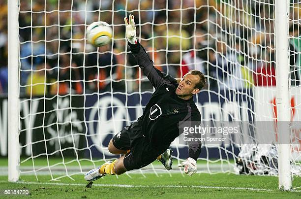 Mark Schwarzer of the Socceroos makes a save in the penalty shootout during the second leg of the 2006 FIFA World Cup qualifying match between...