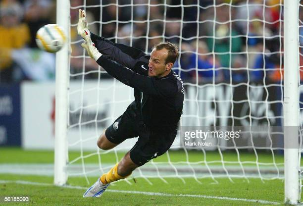 Mark Schwarzer of the Socceroos saves the first goal in the penalty shootout during the second leg of the 2006 FIFA World Cup qualifying match...