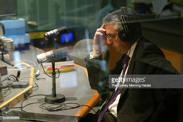 Mark Scott editorial director of John Fairfax Holdings listens to Senator Helen Coonan's assessment of him during an interview on ABC Radio's World...