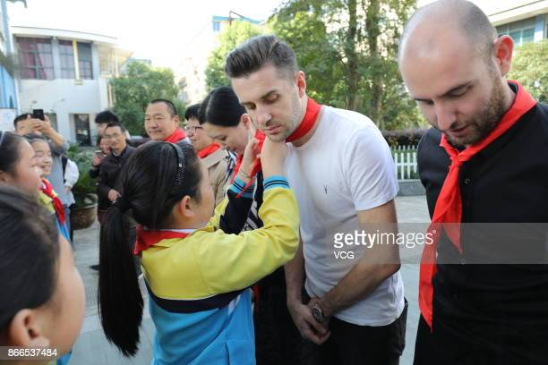 Mark Selby and Matthew Selt of England visit a primary school during the 2017 CBSA Haining Internation Snooker Open on October 25 2017 in Jiaxing...