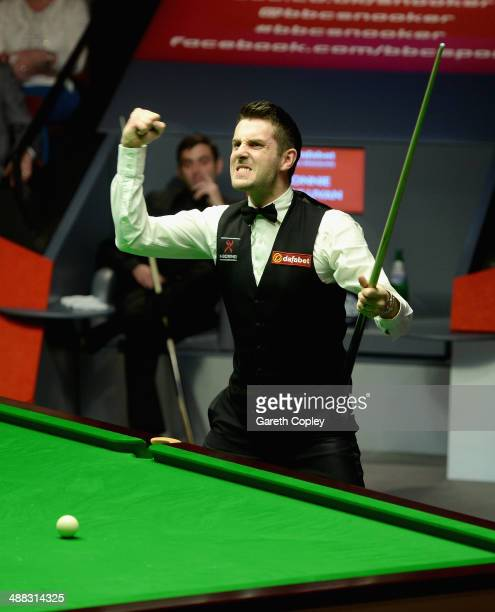 Mark Selby celebrates potting the final black to win The Dafabet World Snooker Championship final at Crucible Theatre on May 5 2014 in Sheffield...