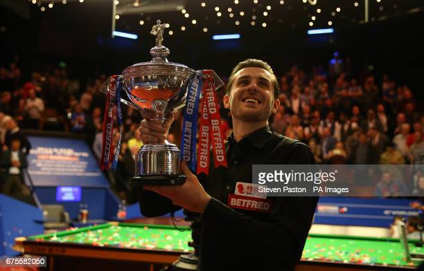 Mark Selby celebrates winning the Betfred Snooker World Championship with his daughter Sofia Maria and wife Vikki Layton on day seventeen of the...