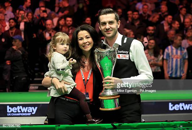 Mark Selby celebrates winning the Betway UK Championship with his daughter Sofia Maria and wife Vikki Layton during day twelve of the Betway UK...