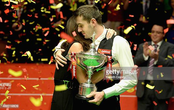 Mark Selby lifts the trophy with wife Vikki after winning The Dafabet World Snooker Championship final at Crucible Theatre on May 5 2014 in Sheffield...